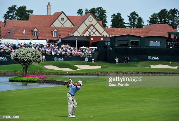 Steve Stricker hits his approach shot to the 18th green during the first round of the 93rd PGA Championship at the Atlanta Athletic Club on August 11...