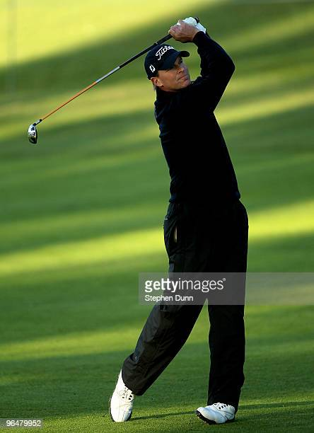 Steve Stricker hits his second shot on the 18th hole during the continuation third round of the Northern Trust Open at Riviera Country Club on...