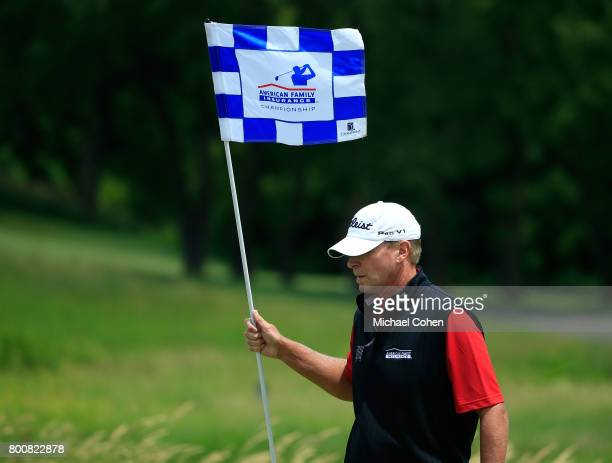 Steve Stricker holds the flag stick on the sixth green during the third and final round of the American Family Insurance Championship held at...