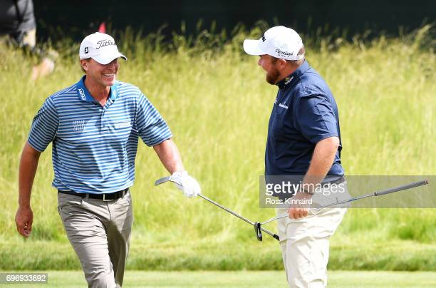 Steve Stricker of the United States and Shane Lowry of Ireland react on the sixth green during the third round of the 2017 US Open at Erin Hills on...