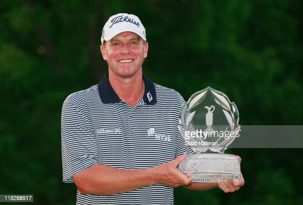 Steve Stricker poses with the trophy after winning the Memorial Tournament presented by Nationwide Insurance at the Muirfield Village Golf Club on...