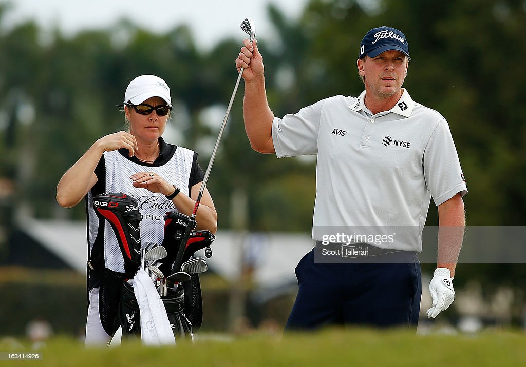Steve Stricker pulls a club on the first hole as his wife/caddie Nicki looks on during the third round of the World Golf Championships-Cadillac Championship at the Trump Doral Golf Resort & Spa on March 9, 2013 in Doral, Florida.