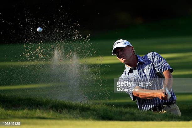 Steve Stricker pulls out from the bunker on the 15th hole during the second round of the Deutsche Bank Championship at TPC Boston on September 4 2010...