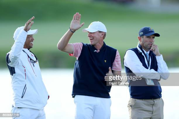 Steve Stricker the captain of the United States Team and Tiger Woods one of his assistant captains react to Phil Mickelson's match winning putt on...