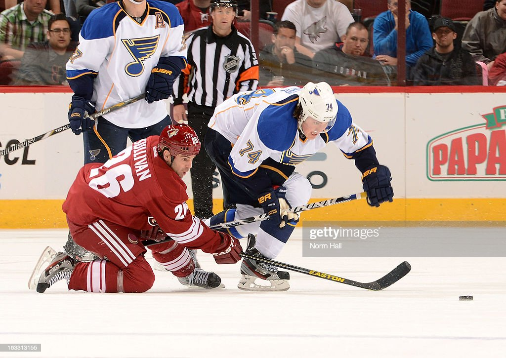 <a gi-track='captionPersonalityLinkClicked' href=/galleries/search?phrase=Steve+Sullivan&family=editorial&specificpeople=201723 ng-click='$event.stopPropagation()'>Steve Sullivan</a> #26 of the Phoenix Coyotes and <a gi-track='captionPersonalityLinkClicked' href=/galleries/search?phrase=T.J.+Oshie&family=editorial&specificpeople=700383 ng-click='$event.stopPropagation()'>T.J. Oshie</a> #74 of the St Louis Blues battle for control of the puck during the third period at Jobing.com Arena on March 7, 2013 in Glendale, Arizona.