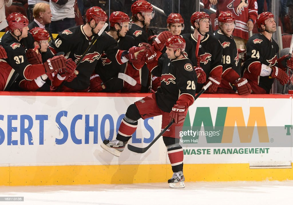 <a gi-track='captionPersonalityLinkClicked' href=/galleries/search?phrase=Steve+Sullivan&family=editorial&specificpeople=201723 ng-click='$event.stopPropagation()'>Steve Sullivan</a> #26 of the Phoenix Coyotes is congratulated by teammates after scoring in the overtime shootout against the Anaheim Ducks at Jobing.com Arena on March 4, 2013 in Glendale, Arizona.