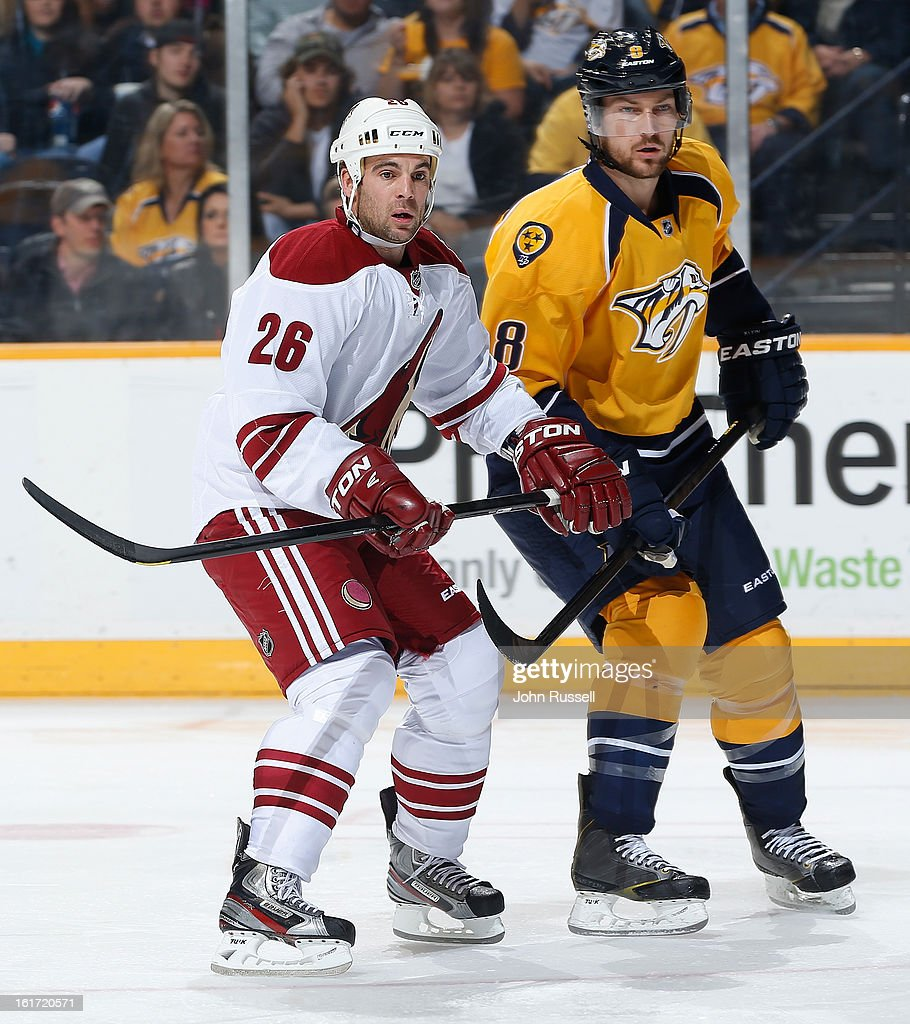 Steve Sullivan #26 of the Phoenix Coyotes skates against Kevin Klein #8 of the Nashville Predators during an NHL game at the Bridgestone Arena on February 14, 2013 in Nashville, Tennessee.