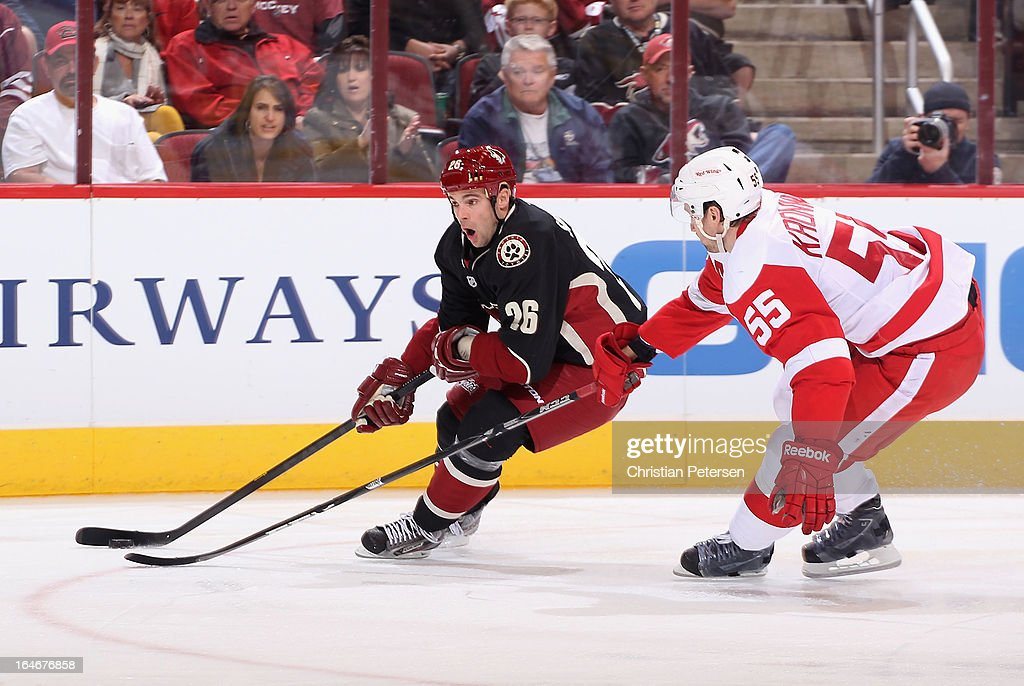<a gi-track='captionPersonalityLinkClicked' href=/galleries/search?phrase=Steve+Sullivan&family=editorial&specificpeople=201723 ng-click='$event.stopPropagation()'>Steve Sullivan</a> #26 of the Phoenix Coyotes skates with the puck past <a gi-track='captionPersonalityLinkClicked' href=/galleries/search?phrase=Niklas+Kronwall&family=editorial&specificpeople=220826 ng-click='$event.stopPropagation()'>Niklas Kronwall</a> #55 of the Detroit Red Wings during the NHL game at Jobing.com Arena on March 25, 2013 in Glendale, Arizona. The Red Wings defeated the Coyotes 3-2.
