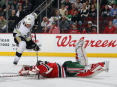 Steve Sullivan of the Pittsburgh Penguins is stopped by Martin Brodeur of the New Jersey Devils at the Prudential Center on March 17 2012 in Newark...