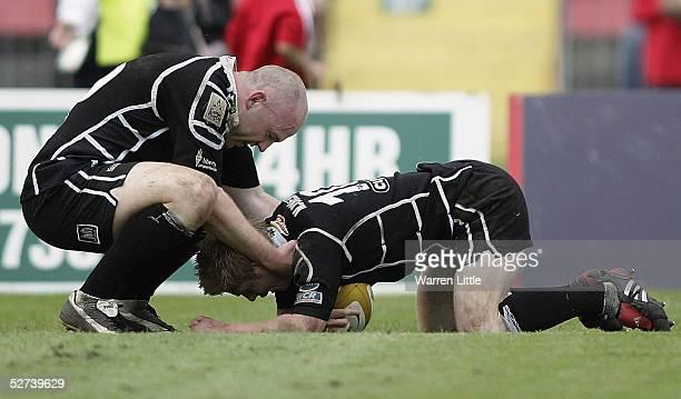 Steve Tandy congratulates team mate Matthew Jones after scoring a try during the Celtic Cup Quarter Final match between Neath and Swansea Ospreys...