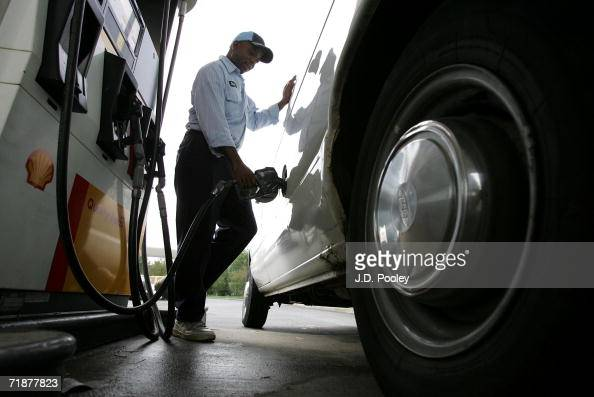 Steve Taylor pumps gas at a gas station on September 13 in Toledo Ohio Taylor who is employed by a carpet cleaning service works days driving to...
