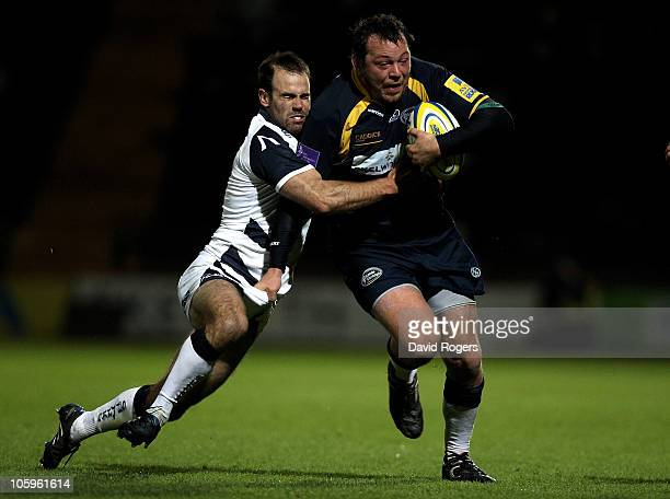 Steve Thompson of Leeds is tackled by Charlie Hodgson during the Aviva Premiership match between Leeds Carnegie and Sale Sharks at Headingley...