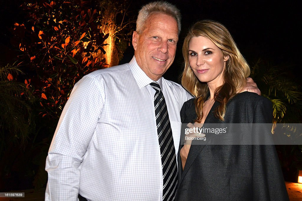 Steve Tisch, an owner of the New York Giants, poses for a portrait with guest Nicole Dairy during a party hosted by Tom and Gayle Benson, owners of the New Orleans Saints, for NFL team owners in New Orleans, Louisiana, U.S., on Thursday, Jan. 31, 2013. The party in City Park kicked off a weekend of festivities before Super Bowl XLVII. Photographer: Amanda Gordon/Bloomberg via Getty Images
