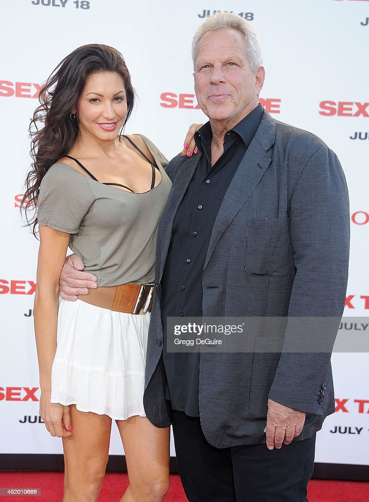 <a gi-track='captionPersonalityLinkClicked' href=/galleries/search?phrase=Steve+Tisch&family=editorial&specificpeople=235783 ng-click='$event.stopPropagation()'>Steve Tisch</a> and guest arrive at the Los Angeles premiere of 'Sex Tape' at Regency Village Theatre on July 10, 2014 in Westwood, California.