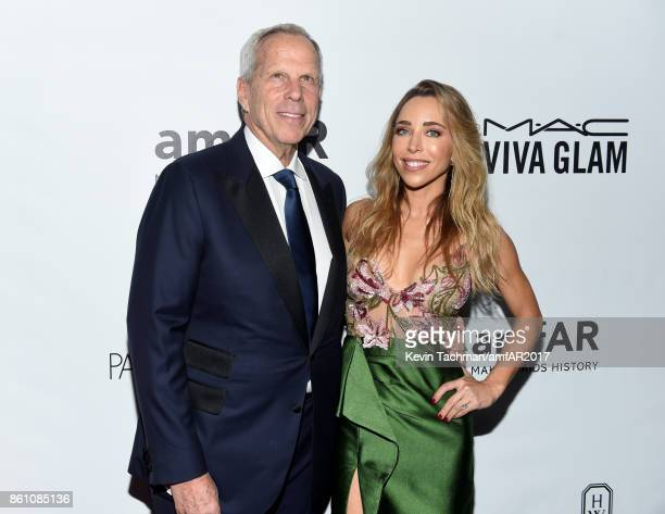 Steve Tisch and guest at amfAR Los Angeles 2017 at Ron Burkle's Green Acres Estate on October 13 2017 in Beverly Hills Californi