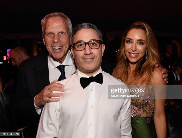 Steve Tisch Jason Weinberg and Katia Francesconi attend the amfAR Gala Los Angeles 2017 at Ron Burkle's Green Acres Estate on October 13 2017 in...
