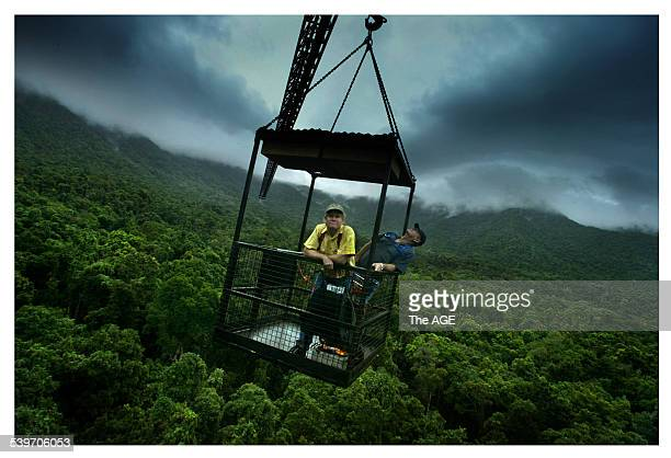 Steve Turton left and Dick Cooper hitch a lift on the Australian Canopy Crane a 45metre structure in the rainforest at Cape Tribulation 10 November...