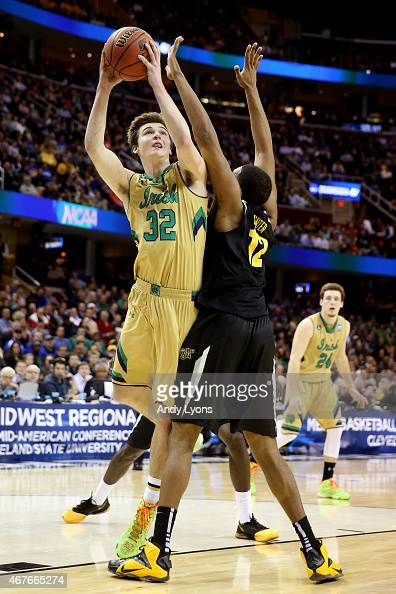 Steve Vasturia of the Notre Dame Fighting Irish drives to the basket against Darius Carter of the Wichita State Shockers in the first half during the...