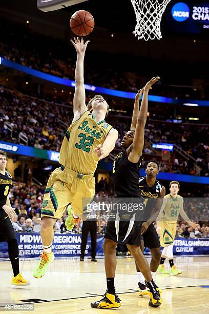 Steve Vasturia of the Notre Dame Fighting Irish shoots against Darius Carter of the Wichita State Shockers in the first half during the Midwest...