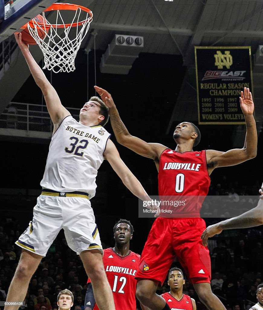 Steve Vasturia #32 of the Notre Dame Fighting Irish shoots the ball as V.J. King #0 of the Louisville Cardinals defends at Purcell Pavilion on January 4, 2017 in South Bend, Indiana.