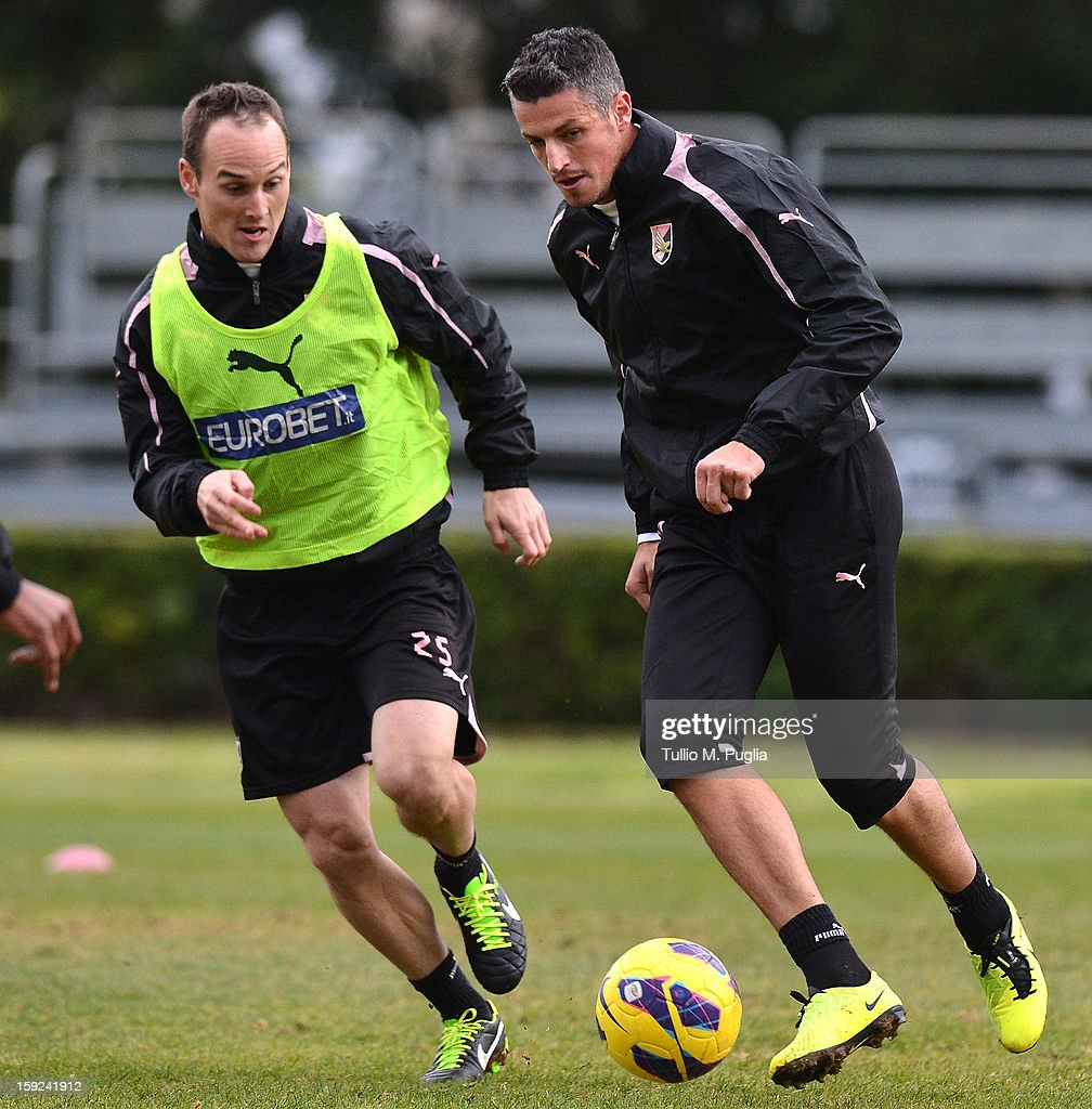 Steve Von Bergen (L) and Igor Budan of Palermo in action during a training session at Tenente Carmelo Onorato Sports Center on January 10, 2013 in Palermo, Italy.