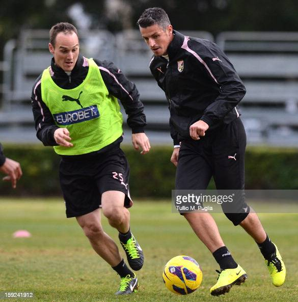 Steve Von Bergen and Igor Budan of Palermo in action during a training session at Tenente Carmelo Onorato Sports Center on January 10 2013 in Palermo...