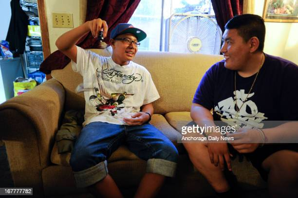 Steve Vue and Mitchell Xayapraseuth talk in the living room of Steve's house on the first night of the ceremony Steve's cancer treatment was over but...