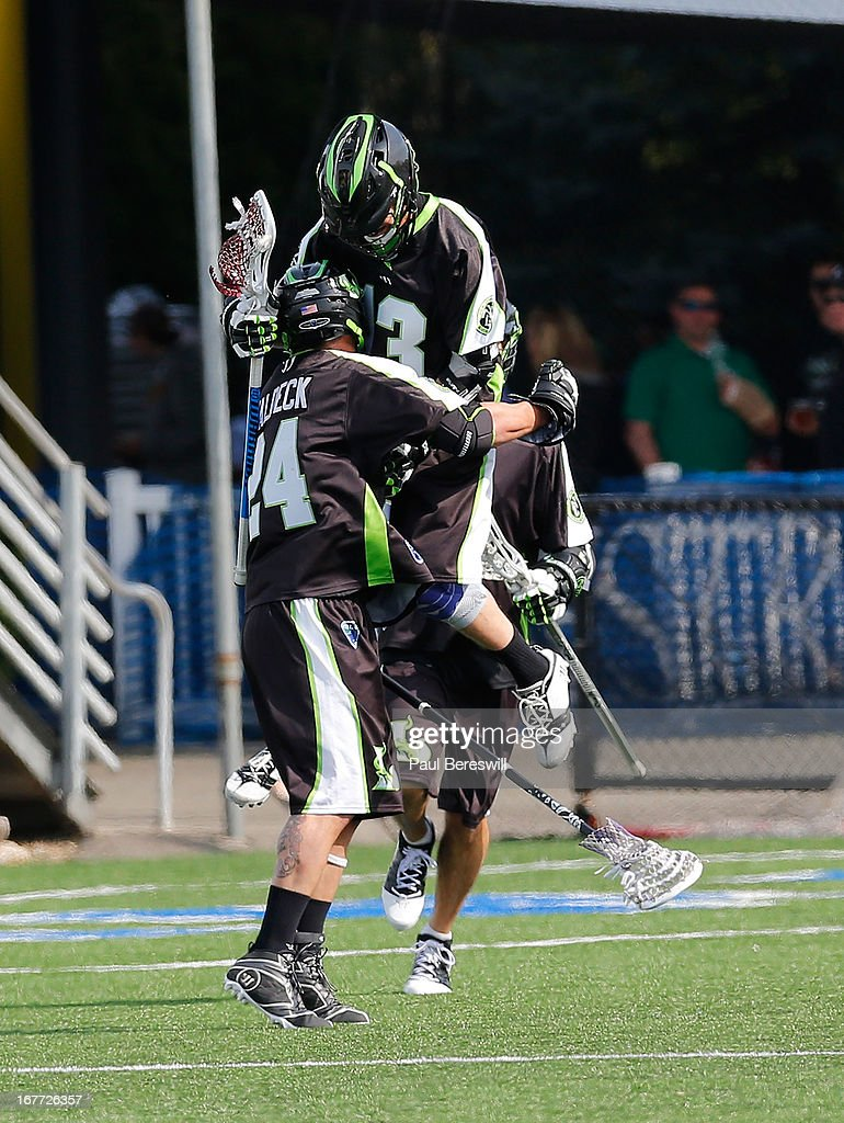 Steve Waldeck #24 of the New York Lizzards celebrates scoring a goal with teammate Stephen Berger #13 during the first half of a Major League Lacrosse game against the Boston Cannona at James M. Shuart Stadium on April 28, 2013 in Hempstead, New York.