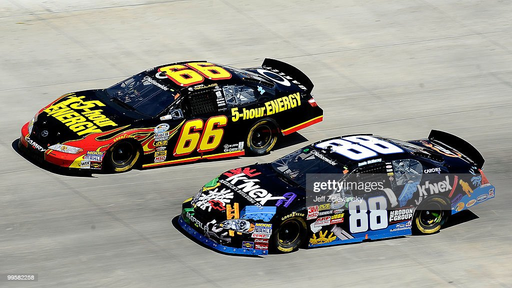 Steve Wallace, driver of the 5-Hour Energy Toyota races with <a gi-track='captionPersonalityLinkClicked' href=/galleries/search?phrase=Jamie+McMurray&family=editorial&specificpeople=198964 ng-click='$event.stopPropagation()'>Jamie McMurray</a>, driver of the #8 K-Nex Chevrolet during the NASCAR Nationwide Series Heluva Good! 200 at Dover International Speedway on May 15, 2010 in Dover, Delaware.