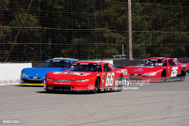 Steve Wallace Rusty Wallace Racing Ford Fusion races Garrett Jones Chevrolet SS and Chandler Smith Chevrolet SS on the backstretch in the 41st Annual...