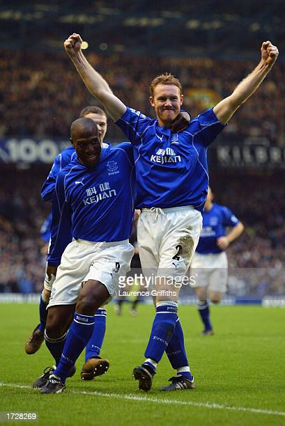 Steve Watson of Everton celebrates scoring with Kevin Campbell and Wayne Rooney of Everton during the FA Barclaycard Premiership match between...