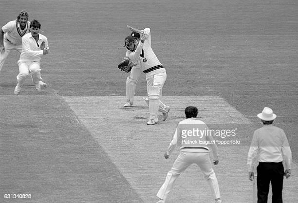 Steve Waugh of Australia drives a delivery from England bowler John Emburey during his innings of 71 runs in the 2nd Test match between Australia and...