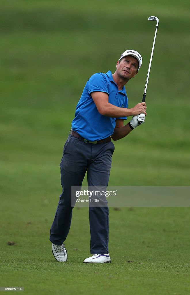 Steve Webster of England plays his second shot into the 18th green in the first extra play-off hole during the second round of The Nelson Mandela Championship presented by ISPS Handa at Royal Durban Golf Club on December 9, 2012 in Durban, South Africa.