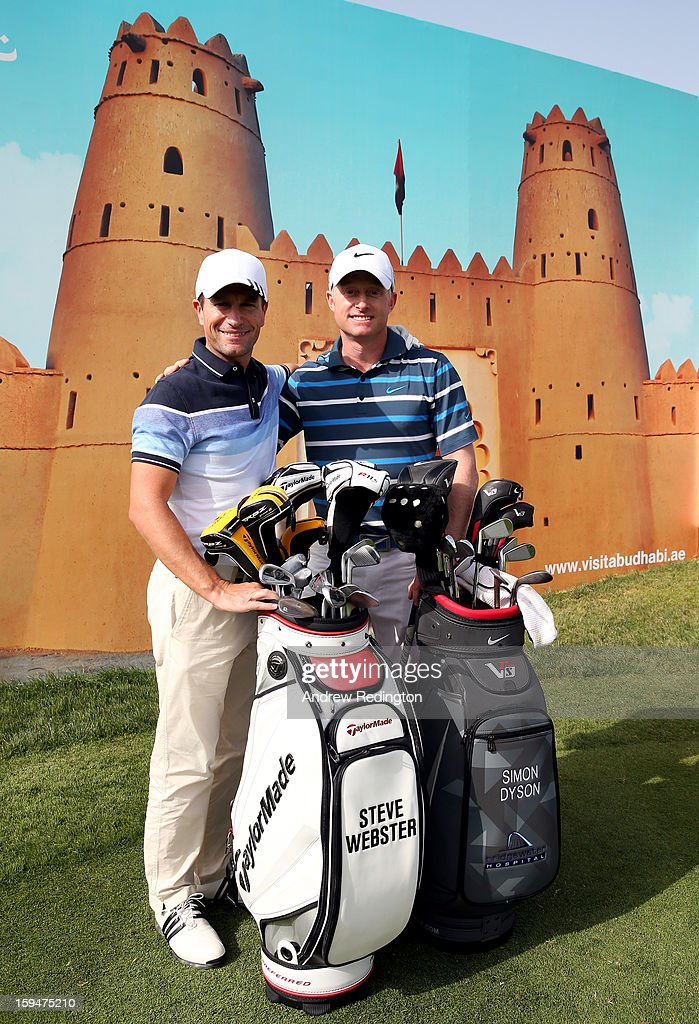 Steve Webster (left) Simon Dyson of England pose for a photograph in front of an advertising board during practice for The Abu Dhabi HSBC Golf Championship at Abu Dhabi Golf Club on January 14, 2013 in Abu Dhabi, United Arab Emirates.