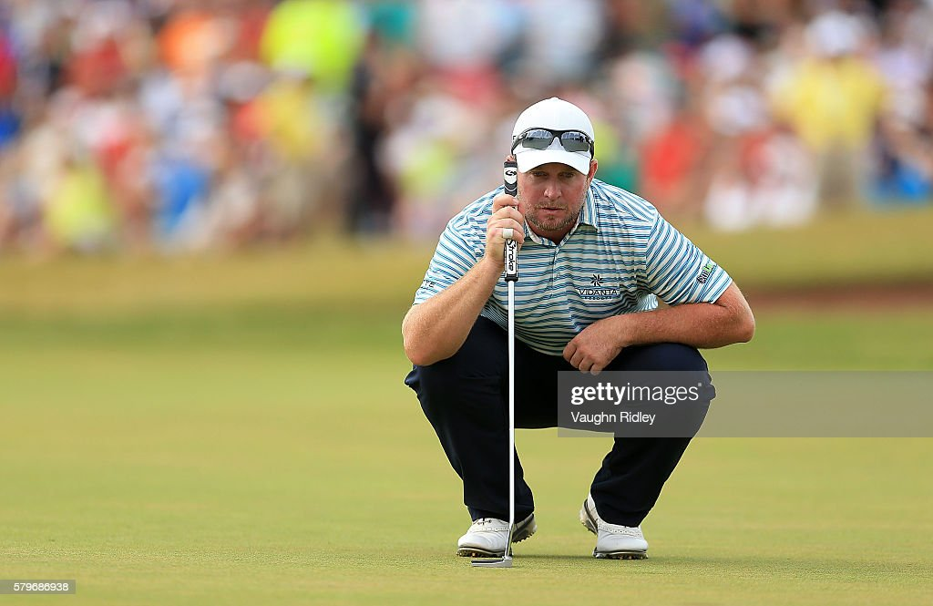 Steve Wheatcroft of the United States lines up a putt on the 18th green during the final round of the RBC Canadian Open at Glen Abbey Golf Club on...