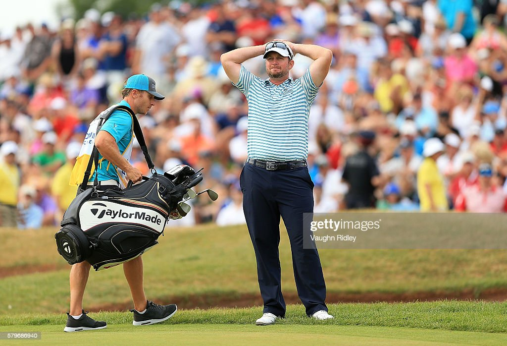 Steve Wheatcroft of the United States reacts to his shot that went into the water on the 18th green during the final round of the RBC Canadian Open...