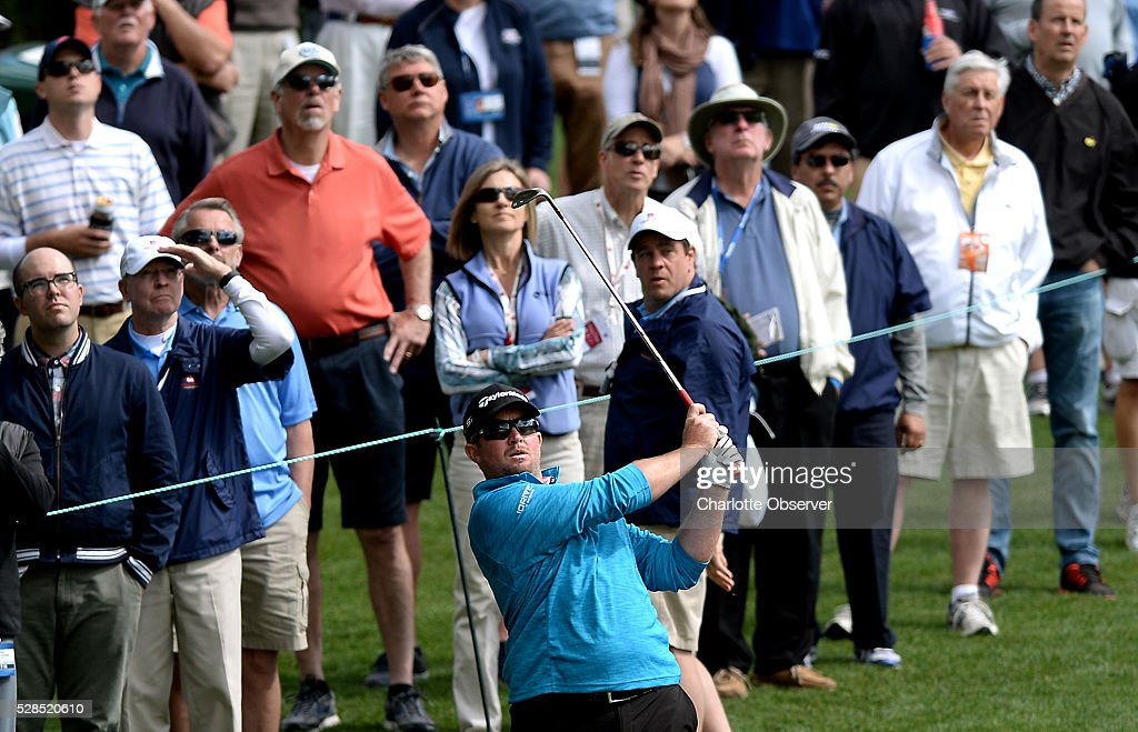 Steve Wheatcroft watches the flight of his ball to the 14th green along with the gallery during the first round of the Wells Fargo Championship at Quail Hollow Club in Charlotte, N.C., on Thursday, May 5, 2016.