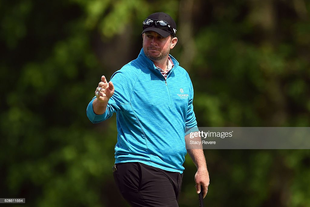 Steve Wheatcroft waves to the crowd following a birdie on the 12th hole during the first round of the Wells Fargo Championship at Quail Hollow on May 5, 2016 in Charlotte, North Carolina.