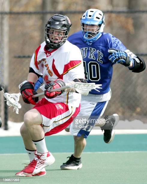 Steve Whittenberg moves away from Matt Danowski of Duke at the University of Maryland in College Park Maryland on March 5 2005 Duke won 108