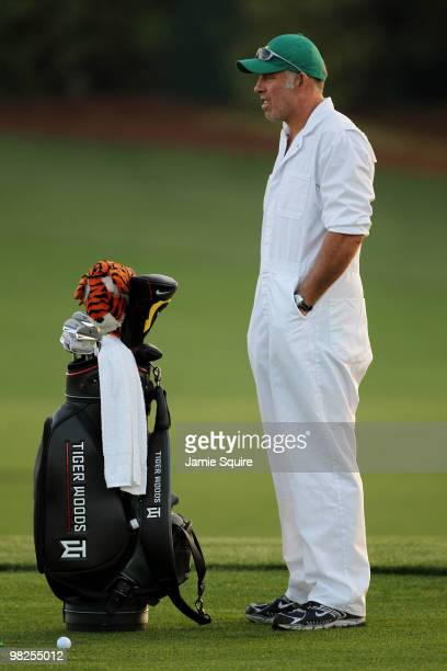 Steve Williams caddie to Tiger Woods looks on from the practice range during a practice round prior to the 2010 Masters Tournament at Augusta...