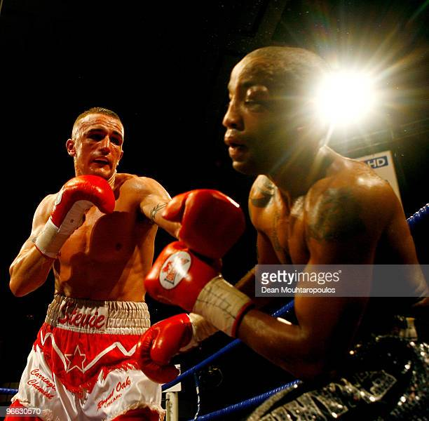 Steve Williams of Liverpool lands a punch on Michael Grant of Tottenham in their English LightWelterweight title bout at York Hall on February 12...