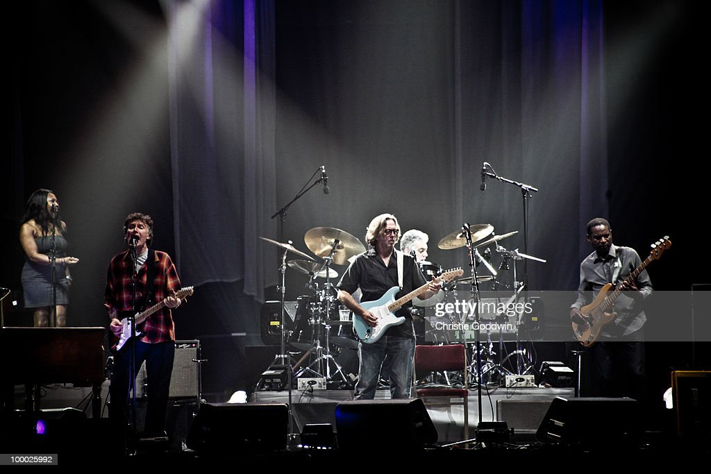 Steve Winwood (L) and Eric Clapton (C) perform on stage at Wembley Arena on May 20, 2010 in London, England.