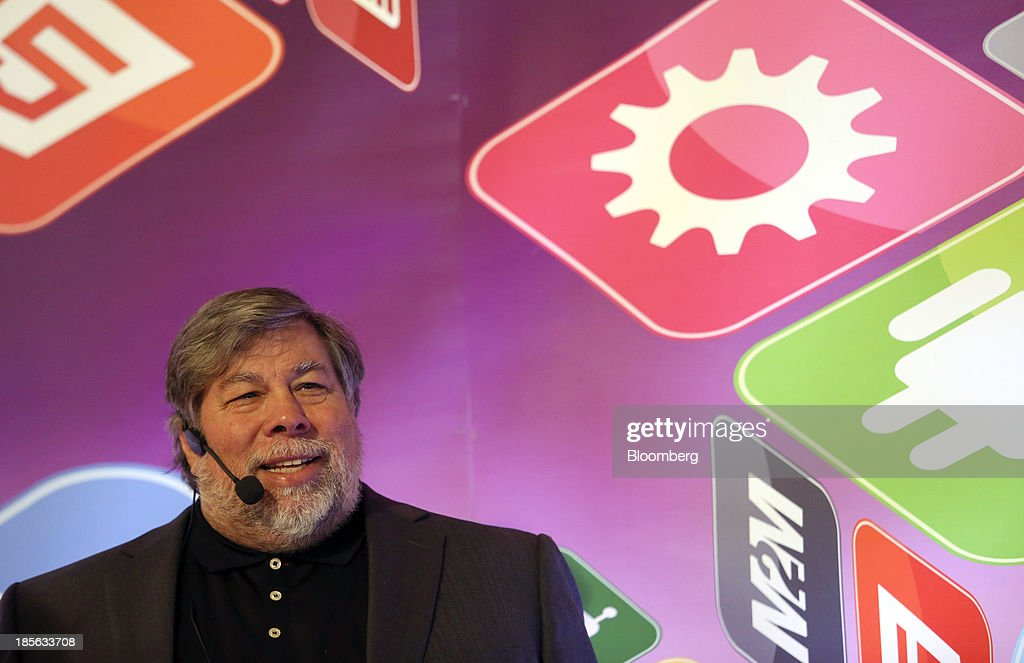 Steve Wozniak, co-founder of Apple Inc. and chief scientist of Fusion-io Inc., waits to speak during the Apps World Multi-Platform Developer Show in London, U.K., on Wednesday, Oct. 23, 2013. Retail sales of Internet-connected wearable devices, including watches and eyeglasses, will reach $19 billion by 2018, compared with $1.4 billion this year, Juniper Research said in an Oct. 15 report. Photographer: Chris Ratcliffe/Bloomberg via Getty Images