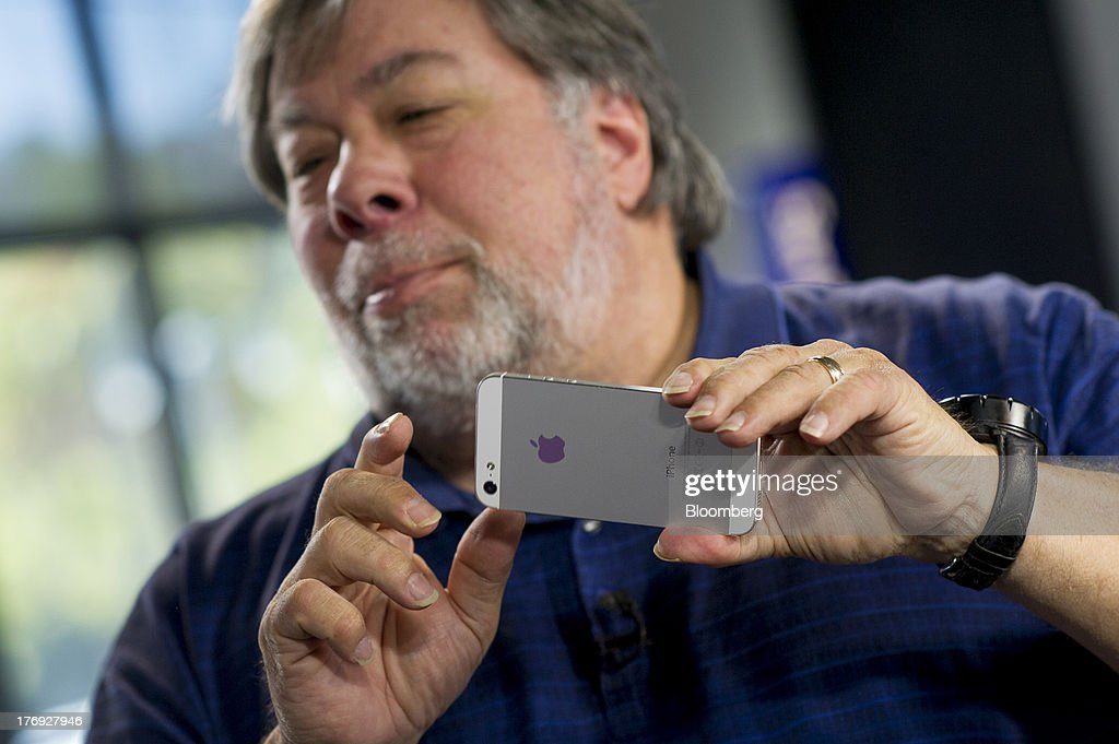 Steve Wozniak, co-founder of Apple Inc., holds his Apple Inc. iPhone after a Bloomberg West Television interview in San Francisco, California, U.S., on Friday, Aug. 16, 2013. Wozniak talked about Apple co-founder Steve Jobs and the movie 'Jobs.' Photographer: David Paul Morris/Bloomberg via Getty Images
