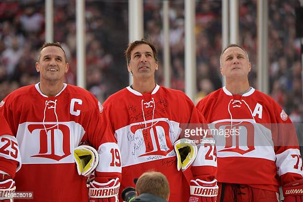 Steve Yzerman Chris Chelios and Paul Coffey of the Detroit Red Wings stand on the ice for the national anthem before the game against the Toronto...