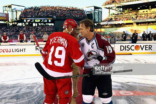 Steve Yzerman of the Detroit Red Wings Alumni and Joe Sakic of the Colorado Avalanche Alumni shake hands prior to the 2016 Coors Light Stadium Series...