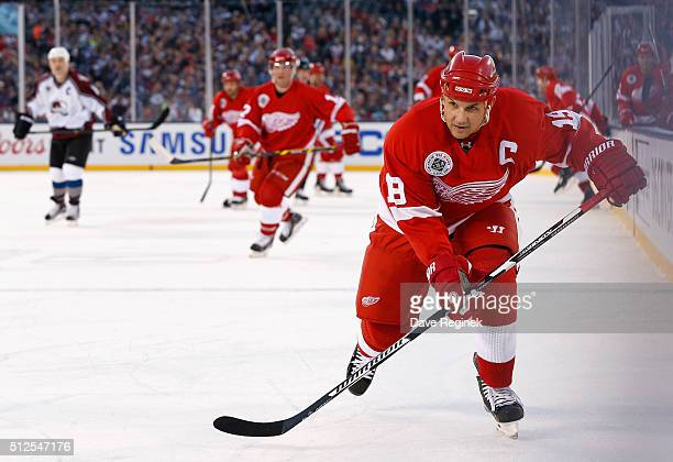 Steve Yzerman of the Detroit Red Wings Alumni skates along the side boards during the 2016 Coors Light Stadium Series Alumni Game against the...