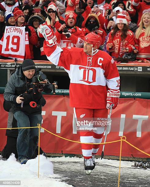 Steve Yzerman of the Detroit Red Wings Alumni waves to the crowd after being announced before the 2014 Bridgestone NHL Winter Classic Alumni Game Two...