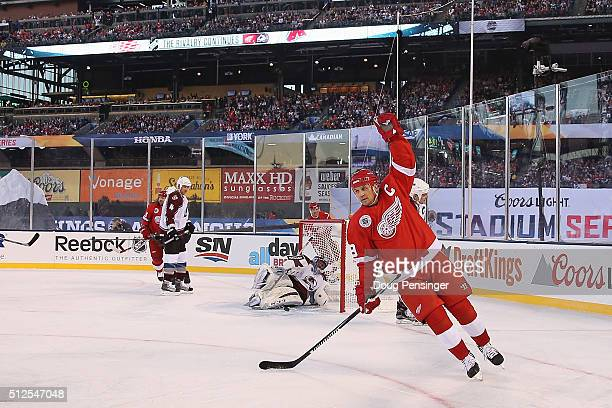 Steve Yzerman of the Detroit Red Wings celebrates a goal against goalie Patrick Roy of the Colorado Avalanche to tie the score 11 in the first period...