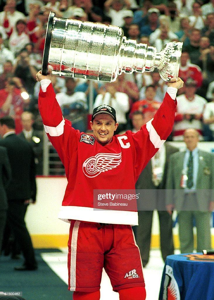 Steve Yzerman of the Detroit Red Wings hoists Stanley Cup during post game celebration at the Joe Louis Arena